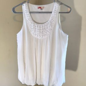 white top with pearl details